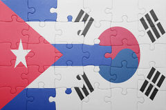 Puzzle with the national flag of cuba and south korea. Concept stock image