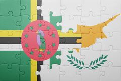 Puzzle with the national flag of cyprus and dominica. Concept royalty free stock photo