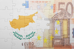 Puzzle with the national flag of cyprus and euro banknote. Concept Royalty Free Stock Photography