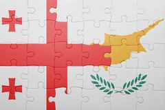 Puzzle with the national flag of cyprus and georgia Stock Images