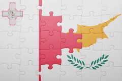 Puzzle with the national flag of cyprus and malta. Concept Royalty Free Stock Images