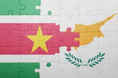 Puzzle with the national flag of cyprus and suriname. Concept Stock Images