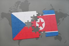 puzzle with the national flag of czech republic and north korea on a world map Stock Images