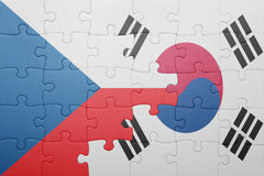 Puzzle with the national flag of czech republic and south korea Stock Image