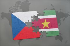 Puzzle with the national flag of czech republic and suriname on a world map. Background. 3D illustration Royalty Free Stock Photo