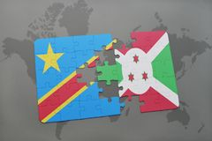 Puzzle with the national flag of democratic republic of the congo and burundi on a world map Stock Photography