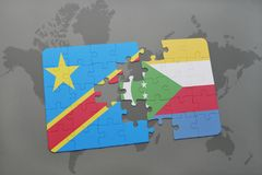 Puzzle with the national flag of democratic republic of the congo and comoros on a world map Stock Photos