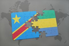Puzzle with the national flag of democratic republic of the congo and gabon on a world map Royalty Free Stock Images