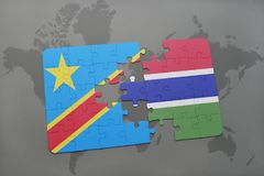 Puzzle with the national flag of democratic republic of the congo and gambia on a world map Royalty Free Stock Photo
