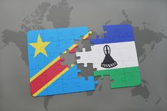 Puzzle with the national flag of democratic republic of the congo and lesotho on a world map Royalty Free Stock Images