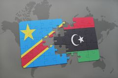 Puzzle with the national flag of democratic republic of the congo and libya on a world map Royalty Free Stock Photos
