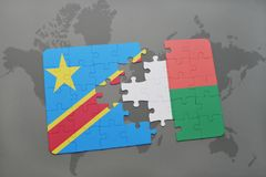 Puzzle with the national flag of democratic republic of the congo and madagascar on a world map Stock Images