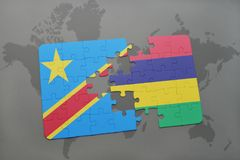 Puzzle with the national flag of democratic republic of the congo and mauritius on a world map Royalty Free Stock Images