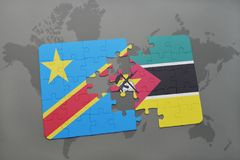 Puzzle with the national flag of democratic republic of the congo and mozambique on a world map Royalty Free Stock Photography