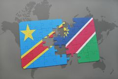 Puzzle with the national flag of democratic republic of the congo and namibia on a world map Royalty Free Stock Photography