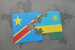 Puzzle with the national flag of democratic republic of the congo and rwanda on a world map Royalty Free Stock Image