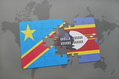 Puzzle with the national flag of democratic republic of the congo and swaziland on a world map Stock Photos