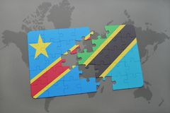 Puzzle with the national flag of democratic republic of the congo and tanzania on a world map Royalty Free Stock Image