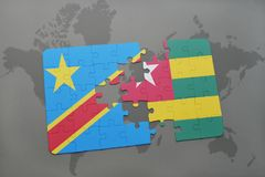 Puzzle with the national flag of democratic republic of the congo and togo on a world map Stock Photography