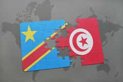 Puzzle with the national flag of democratic republic of the congo and tunisia on a world map Stock Image