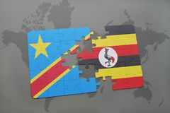 Puzzle with the national flag of democratic republic of the congo and uganda on a world map Royalty Free Stock Images