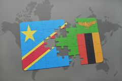 Puzzle with the national flag of democratic republic of the congo and zambia on a world map Royalty Free Stock Photography