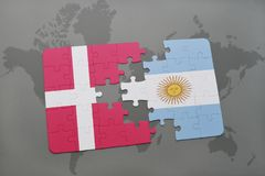 Puzzle with the national flag of denmark and argentina on a world map background. Royalty Free Stock Photography