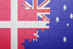 Puzzle with the national flag of denmark and australia. Concept Stock Photography