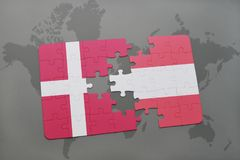 Puzzle with the national flag of denmark and austria on a world map background. 3D illustration Royalty Free Stock Image
