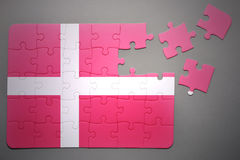 Puzzle with the national flag of denmark Royalty Free Stock Photos