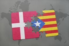 Puzzle with the national flag of denmark and catalonia on a world map background. 3D illustration Stock Photography