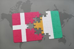Puzzle with the national flag of denmark and cote divoire on a world map background. 3D illustration Stock Image