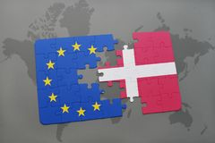 Puzzle with the national flag of denmark and european union on a world map background. Concept Royalty Free Stock Photos