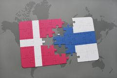 Puzzle with the national flag of denmark and finland on a world map background. 3D illustration Royalty Free Stock Photography