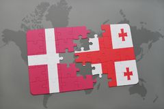 Puzzle with the national flag of denmark and georgia on a world map background. 3D illustration Stock Image