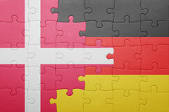 Puzzle with the national flag of denmark and germany Royalty Free Stock Photography