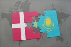 Puzzle with the national flag of denmark and kazakhstan on a world map background. 3D illustration Stock Image