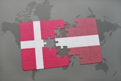 Puzzle with the national flag of denmark and latvia on a world map background. 3D illustration Royalty Free Stock Photo