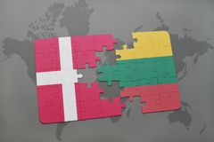 Puzzle with the national flag of denmark and lithuania on a world map background. 3D illustration Stock Photo