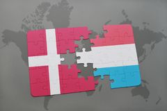puzzle with the national flag of denmark and luxembourg on a world map background. Royalty Free Stock Image