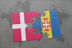 Puzzle with the national flag of denmark and madeira on a world map background. 3D illustration Stock Photo