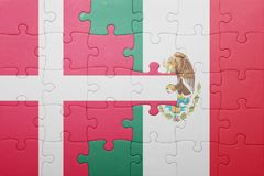 Puzzle with the national flag of denmark and mexico. Concept stock photo