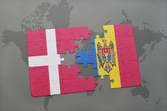 Puzzle with the national flag of denmark and moldova on a world map background. 3D illustration Stock Images