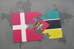 Puzzle with the national flag of denmark and mozambique on a world map background. 3D illustration Stock Photo