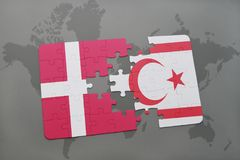 Puzzle with the national flag of denmark and northern cyprus on a world map background. 3D illustration Stock Photography
