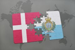 Puzzle with the national flag of denmark and san marino on a world map background. Stock Photo