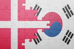 Puzzle with the national flag of denmark and south korea. Concept stock photos