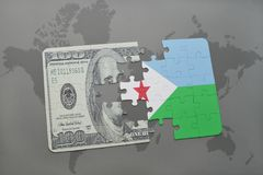 Puzzle with the national flag of djibouti and dollar banknote on a world map background. Stock Photography