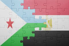 Puzzle with the national flag of djibouti and egypt. Stock Photo