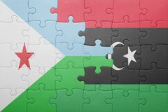 Puzzle with the national flag of djibouti and libya Royalty Free Stock Image